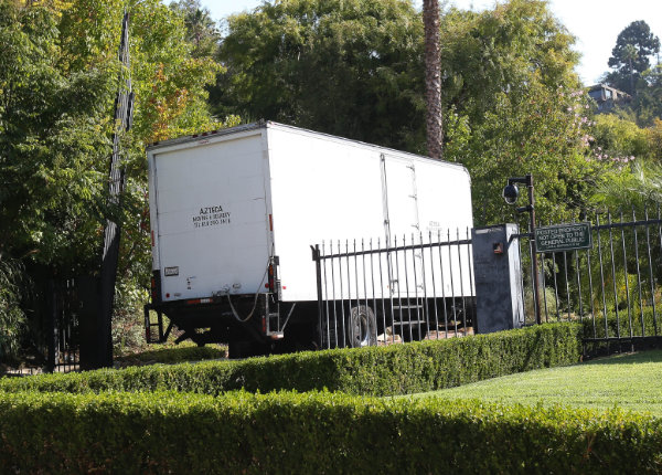 moving vans head to the pitt Jolie compound